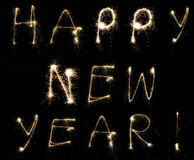Happy New Year!. Happy New Year message spelt by hand using sparklers at night on long exposure Royalty Free Stock Photo