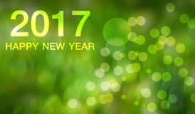 Happy new year 2017 on Abstract  background. Happy new year 2017  Abstract bokeh background.Can be used bokeh texture and bokeh background Royalty Free Stock Photos