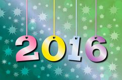 Happy New Year 2016. Abstract blurry background with colorful hanging inscription 2016 years royalty free illustration