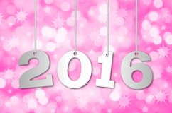 Happy New Year 2016. Abstract blurry background with hanging inscription 2016 years Royalty Free Stock Photography