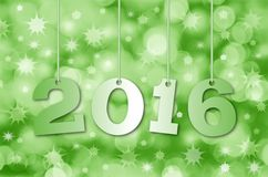 Happy New Year 2016. Abstract blurry background with hanging inscription 2016 years vector illustration