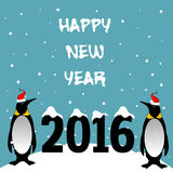 Happy New Year 2016. Abstract colorful background with two penguins with red caps standing near the number 2016 and the text Happy New Year written with white Royalty Free Stock Photos