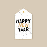 Happy new year. Abstract happy new year label on a brown background Royalty Free Stock Photo