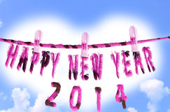 Happy new year 2014. Abstract text with fur effects on cloudy sky background Stock Photos