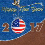 Happy New Year 2017 american flag on Jeans Background. Sewing fabric applique Royalty Free Stock Image