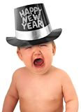 Happy new year baby. Crying baby wearing a happy new year hat royalty free stock image