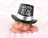 Happy New Year baby. Newborn baby girl wearing a Happy New Year hat Royalty Free Stock Photo