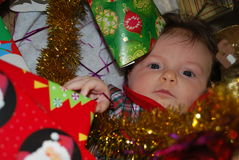 Happy New Year. Baby surrounded by the Christmas stuff royalty free stock photo