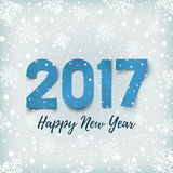 Happy New Year 2017 background. Happy New Year 2017. Blue, Happy New Year 2017 paper typeface on winter background with snow and snowflakes. Happy New Year 2017 Royalty Free Stock Image