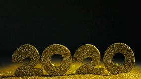 Happy New Year 2020. Happy New Year background with 2020 and falling glitters confetti on black background stock footage