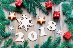 Happy New Year 2018 background with 2018 figures, Christmas toys, blue fir tree branches. New Year 2018 still life Stock Images