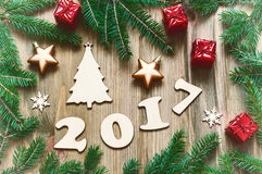 Happy New Year 2017 background with 2017 figures, Christmas toys,fir branches -New Year 2017 still life in vintage tones Royalty Free Stock Images