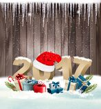 Happy new year background with a 2017 and a gift boxes. Stock Photo