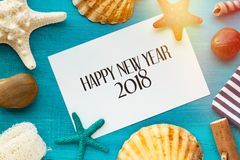 Happy New year background with shells, starfish on a wooden blue Royalty Free Stock Images
