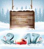Happy New Year 2017 background with a wooden sign. Royalty Free Stock Photography