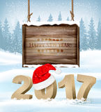 Happy New Year 2017 background with a wooden sign. Royalty Free Stock Images