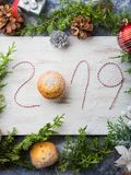 Happy new year background with written 2019. Happy new year background with hand written 2019 with twine and a muffin Stock Photo