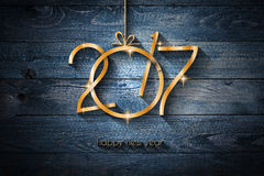 2017 Happy New Year Background for your Flyers. And Greetings Card. Gold text over an old wooden distressed vintage background royalty free illustration