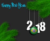Happy New Year 2018 and ball with the Brazil flag. Happy New Year numbers 2018 and christmas ball painted in the colors of the Brazil flag hanging on a Christmas Royalty Free Stock Photos
