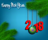 Happy New Year 2018 and ball with the Brazil flag. Happy New Year numbers 2018 and christmas ball painted in the colors of the Brazil flag hanging on a Christmas Stock Photo