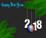 Happy New Year 2018 and ball with the France flag. Happy New Year numbers 2018 and christmas ball painted in the colors of the France flag hanging on a Christmas Royalty Free Stock Image
