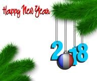 Happy New Year 2018 and ball with the France flag. Happy New Year numbers 2018 and christmas ball painted in the colors of the France flag hanging on a Christmas Royalty Free Stock Photo