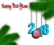 Happy New Year 2018 and ball with the USA flag. Happy New Year numbers 2018 and christmas ball painted in the colors of the USA flag hanging on a Christmas tree Royalty Free Stock Photo