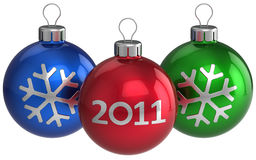 Happy New Year balls (Hi-Res). Three colorful (blue, red, green) shiny christmas balls with silver snowflake shape and 2011 text on them. This is a detailed 3D Stock Photography