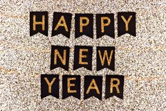 Happy New Year banner on black flags against glittery gold royalty free stock image