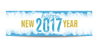 Happy New Year 2017 banner golden text and snowflakes. Happy New Year 2017 banner. Blue background with bokeh, snow, fog and snowflakes. Golden text. Glitter Stock Image