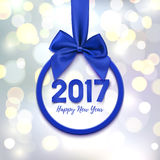 Happy New Year 2017 banner. Happy New Year 2017 round banner with purple ribbon and bow, on abstract background with bokeh circles. Christmas tree decoration Stock Image