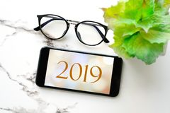 2019, happy new year banner on smart phone device screen background, new year greeting card banner, communication and technology. Concept royalty free stock photo