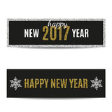 Happy New Year 2017 banners golden text and silver snowflakes. Happy New Year 2017 banners set. Black background. Golden text and frame. Silver snowflakes Stock Images
