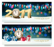 Happy New Year banners with presents and fireworks. Vector stock illustration