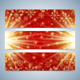 Happy New Year Banners. Red background with golden snowflakes. Stock Photos