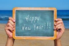 Happy new year on the beach Stock Photo