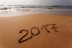 Happy New Year 2017 on the beach. Happy New Year 2017 replace 2016, lettering on the beach Stock Images