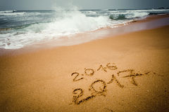 Happy New Year 2017 on the beach. Happy New Year 2017 replace 2016, lettering on the beach