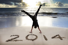 Happy new year 2014 on the beach Stock Photo