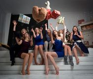 Happy New Year. Beautiful young girls throw gifts at the top and have fun. Real emotions and holiday spirit Stock Images