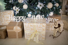 Happy new year. Big letters Happy new year, 3d words design for professional photo shoot. Gifts for children. Waiting for New Year's Eve, gifts from Santa Claus Royalty Free Stock Images