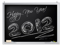 Happy new year on blackboard. For 2012 royalty free illustration