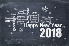 Happy New Year 2018 on blackboard. Happy New Year 2018 word cloud - white chalk text  on a blackboard, a greeting card Royalty Free Stock Photo