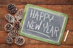 Happy new year blackboard sign stock image