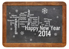 Happy New Year 2014 on blackboard. Happy New Year 2014 word cloud - white chalk text  on a vintage slate blackboard Stock Photography