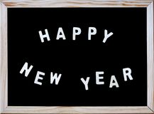 Happy new year on blackboard Royalty Free Stock Photo