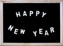 Happy new year on blackboard Royalty Free Stock Photo