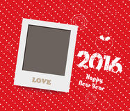 Happy New Year 2016. Blank instant photo frame lovely on red background.  Stock Photo