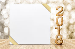Happy new year 2018 with blank white greeting card with gold rib. Bon in perspective room at sparkling bokeh wall and wooden plank floor,leave space for display Royalty Free Stock Photo