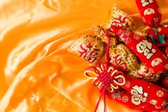 Happy New Year blessing bags, wishful knot, Chinese knot, meaning booming peppers.  Royalty Free Stock Photos